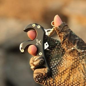 Image 4 - La libération de larc composé de pince de rotation aide la libération de tir à larc de pince à quatre doigts