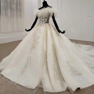 Image 2 - HTL1248 王女のウェディングドレス 2020 毛皮の襟縫製ビーズ上レーススカート背中自由奔放に生きるウェディングロングスリーブ vestido デ noiva