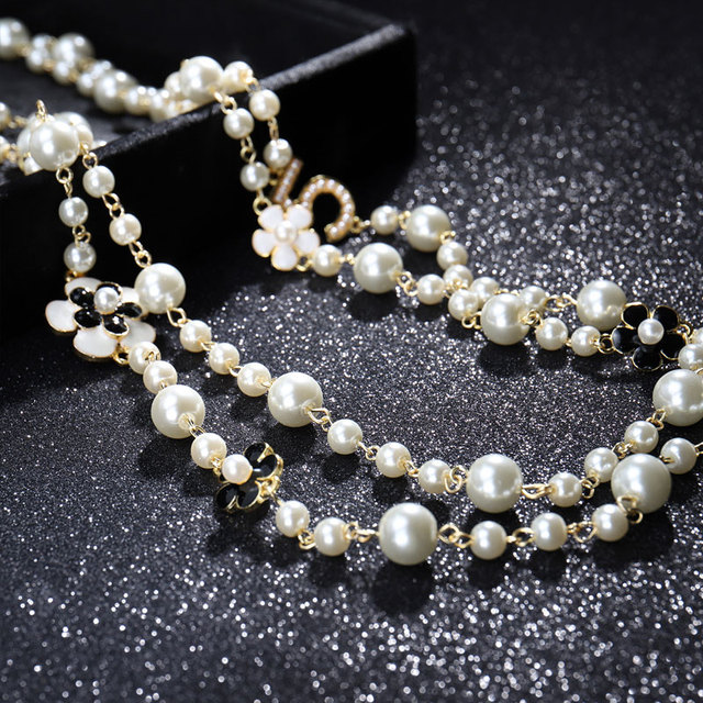 layered pearl and number pendant necklace 6
