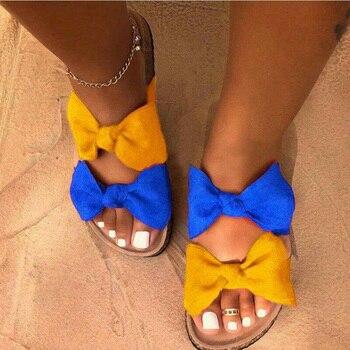 ¡Novedad de 2019! Zapatillas de playa a la moda para mujer, sandalias gruesas con lazo tipo cruz, zapatillas planas de viaje al aire libre con grano de leopardo