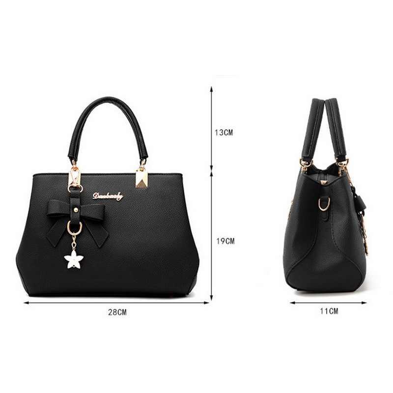 JODIMITTY ผู้หญิงกระเป๋า VINTAGE กระเป๋าถือลำลอง Bowknot จี้กระเป๋าถือผู้หญิงไหล่กระเป๋าหนัง 2020 ใหม่