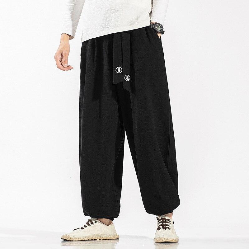 Hommes broderie lâche Harem pantalon décontracté hommes Style chinois haute qualité Vintage pantalon Streetwear mâle solide pantalon 5XL