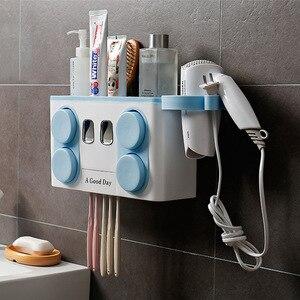 Image 1 - Juego de soporte para cepillo de dientes familiar, estante de almacenamiento de cepillos de dientes de plástico de fácil instalación, dispensador de pasta dental con 4 tazas