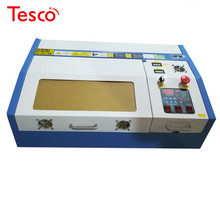 цена на 40W 3020 CO2 laser engraivng and cutting machine with up and down  300*200mm honeycomb working table