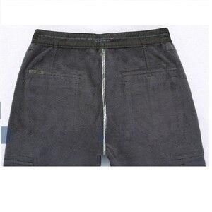 Image 5 - Lã quente inverno carga calças masculinas casuais solto multi bolso masculino 2020 estilo militar do exército verde cáqui tamanho 44 42 40