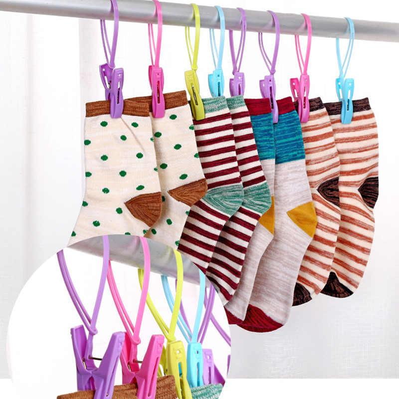 12 piezas de plástico de gancho Portable Clips de lavandería sujetador calcetines colgador Anti viento can CSV