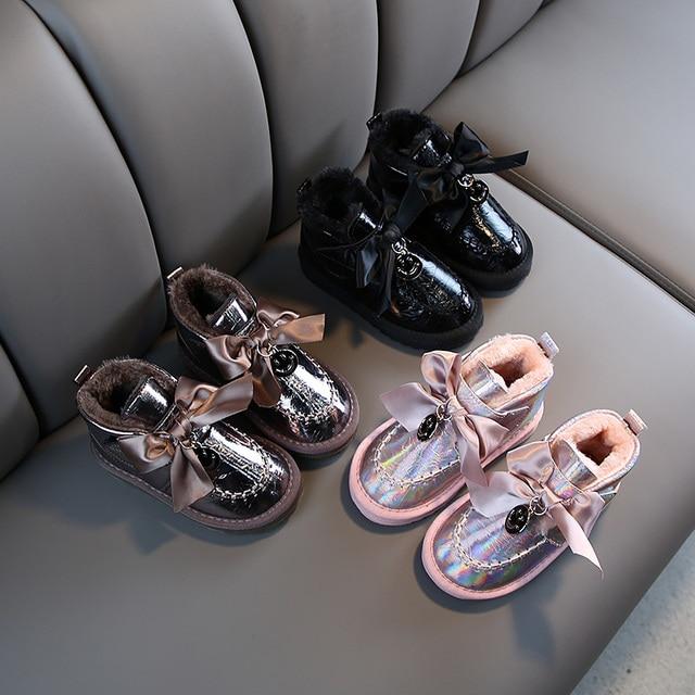 Kinder Schnee Stiefel 2020 Koreanischen Winter Mädchen Fühlte Warme Prinzessin Laser Leder Plüsch Bogen Stiefel Lächeln Wasserdichte Schuhe Mädchen Footware