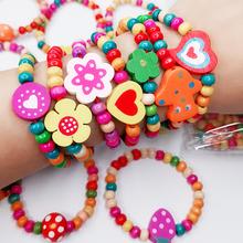 12Pcs Bunte Holz Armbänder Handgemachte Holz Perlen Kinder Kinder Party Klassische Spielzeug Geschenk für Mädchen Junge Elastische Nette hand armband