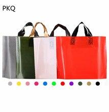 50 piezas 30*20*8cm bolsa de ropa gruesa bolsa de plástico con logotipo personalizado con asa bolsa de compras grande bolsas para ropa de joyería