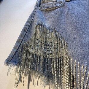 [EWQ] 2020 Spring Summer 2020 Wear Heavy Tassels Nail Diamond Beads High All-match Thin Waist Cowboy Shorts Women AE32305