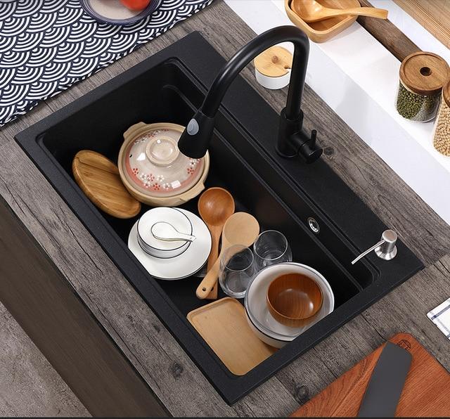 Фото кухонная раковина из кварцевого камня полностью отлитая черная