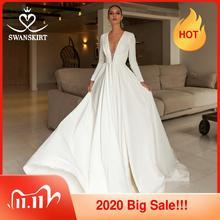 יוקרה חרוזים סאטן חתונת שמלת 2020 אלגנטי v צוואר ארוך שרוול אונליין משפט רכבת הכלה שמלת Swanskirt UZ22 Vestido דה noiva
