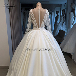 Image 2 - Liyuke 2020 A Line Wedding Dress Ivory Satin Skirt Full Sleeve  Bling Bling Plearls Bridal Dress