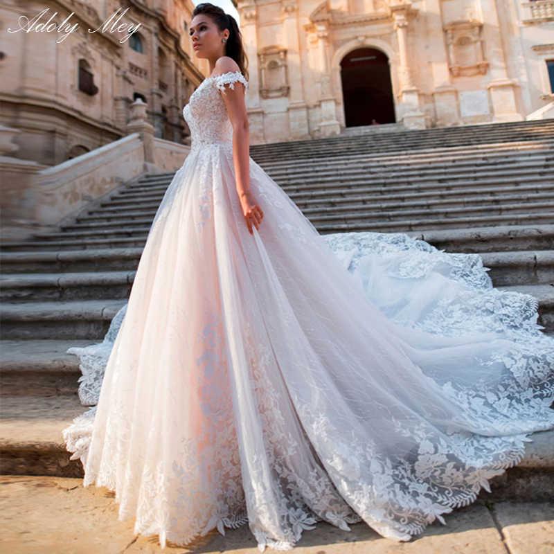 Adoly Mey glamour Appliques dentelle Court Train a-ligne robes de mariée 2020 luxe bateau cou perlé princesse robe de mariée grande taille