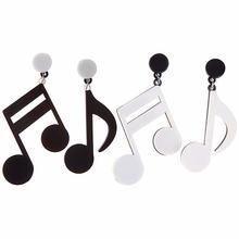 Висячие серьги с асимметричными музыкальными нотами черные красивые
