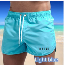 2021 European and American fashion men's summer beach surfing swimming shorts fitness running breathable quick-drying shorts