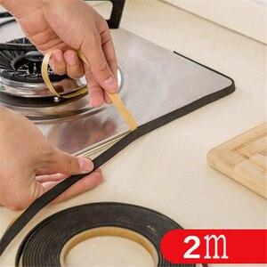 Image 1 - Cinta de sellado para cocina y ventanas, 2 uds., 2M, estufa de Gas, hendidura, tira antiincrustante, cinta de anilla para Cocina