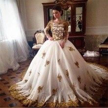 Vestidos De Novia 2020 Luxury Arabic Ball Gown Wedding Dresses Sheer Crew Neck Long Sleeves Gold Lace Appliques Bridal Gowns black cutout details crew neck long sleeves sheer shirt