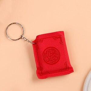 Image 2 - Mini Islamischen Muslimischen Arche Quran Buch Schlüssel Kette Ring Auto Tasche Geldbörse Echte Papier Können Lesen Anhänger Charme Muslimischen Schmuck
