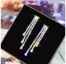 все цены на New Fashion Drop Rhinestone Earrings Personality Tassel Long Design Sparkling Crystal Earrings Female Earring Pendant онлайн