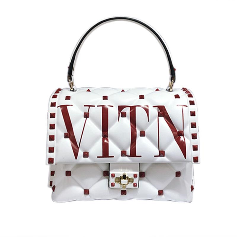 Berühmte Designer Hohe Qualität Echtes Leder Frauen Handtaschen Luxus Mode Niet Brief Design Schulter Messenger Tasche Sac EIN Haupt