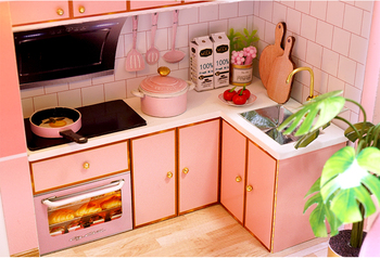 kitchen of the pink dolls house. items on the bench