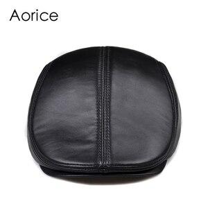 Image 1 - New Design Men 100% Genuine Leather Fashion Baseball Cap/Newsboy /Beret /Cabbie Hat/ Golf Hat Flat Men Slide High Quality HL041