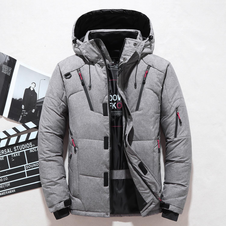 Hommes doudoune de marque mode personnalité poche zippée 2019 hiver nouvelle jeunesse vêtements épais chaud à capuche lâche doudoune