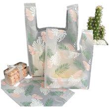 Sacs en plastique pour supermarché, 50 pièces/lot, nouveau matériel, sacs gilet, sacs cadeaux cosmétiques, sac d'emballage alimentaire, sac de bonbons de mariage