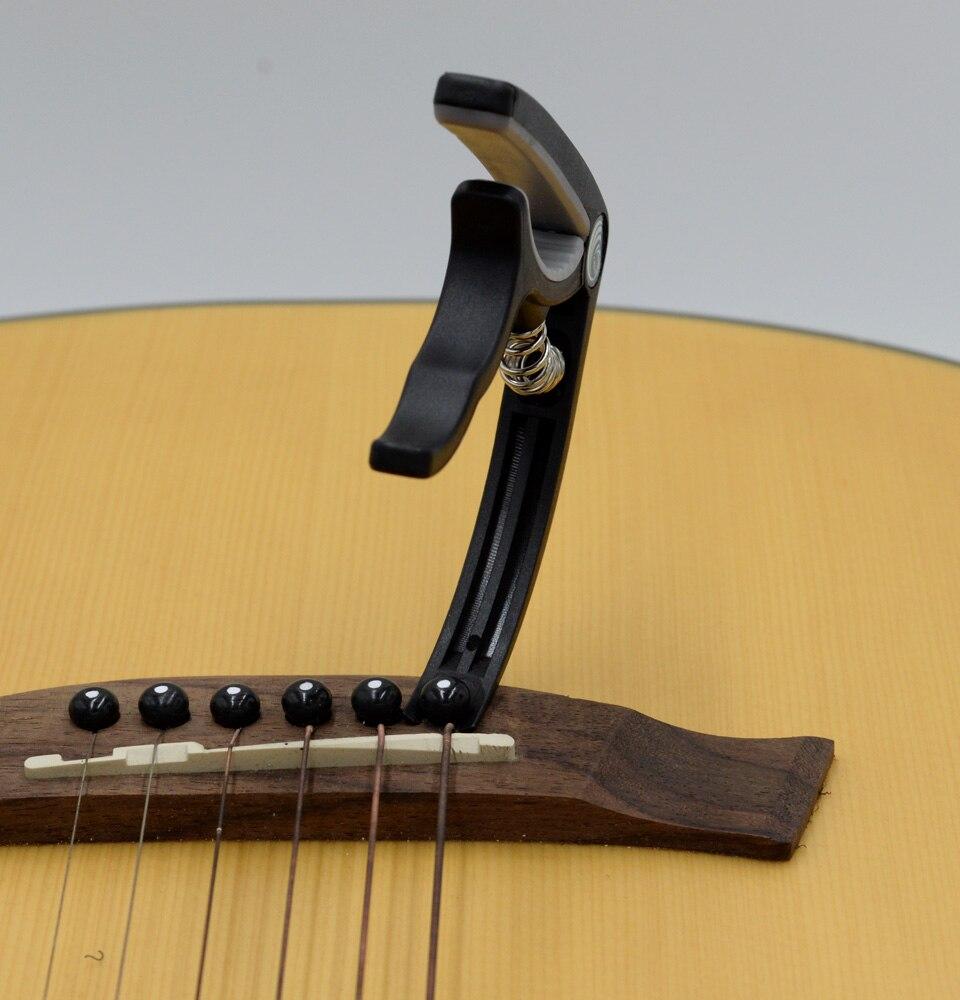 גשר לגיטרה קלאסית אקוסטית בצבע יוקוללה לוקו0ט להזמנה אונליין