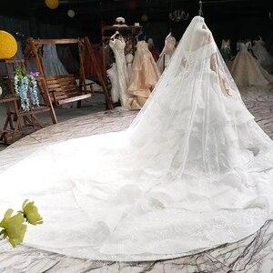 Image 2 - HTL822 מתוקה חתונת שמלות ארוכה רכבת אפליקציות תחרה כלה שמלות כדור שמלה עם צעיף vestidos דה novia 11.11 קידום