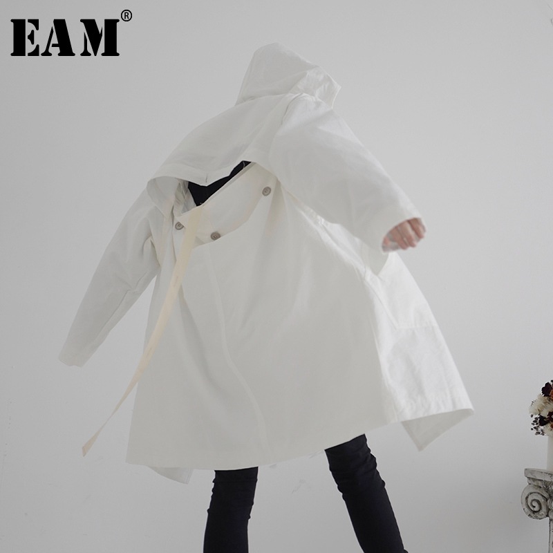 [EAM] Women Back Button Hollow Out Big Size Trench New Hooded Long Sleeve Loose Fit Windbreaker Fashion Tide Spring 2020 1S246