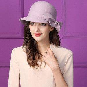 Image 4 - אלגנטי פורמליות נשים צמר כובע חם הרגיש חורף פדורה כובע פרל Bowknot הקלוש Bowler כובע גבירותיי המפלגה דרבי כנסיית חתונה כובע