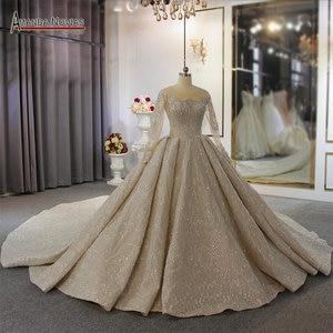 Image 2 - 2020 두바이 럭셔리 웨딩 드레스 긴 소매와 무거운 구슬 신부 드레스 100% 진짜 작업 고품질