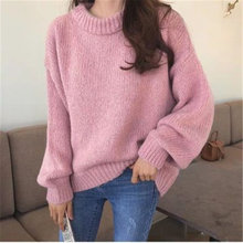 Пуловер женский утепленный однотонный с круглым вырезом и длинным