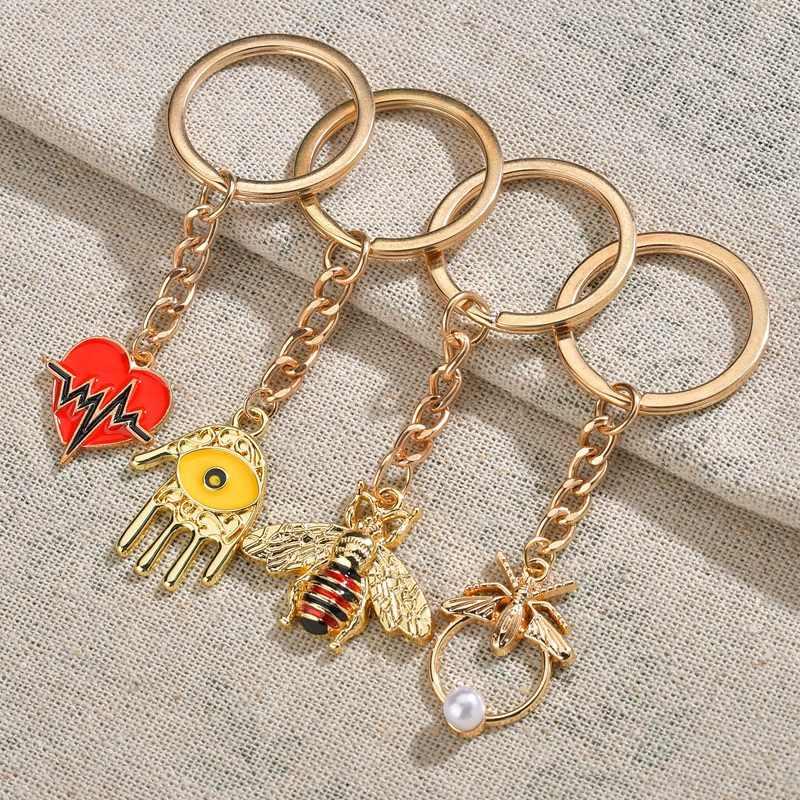 موضة حلقة رئيسية الذهب معدن مفتاح سلسلة الحشرات القلب النخيل المفاتيح للهدايا مجوهرات للجنسين النحل قلادة المينا المجوهرات بالجملة
