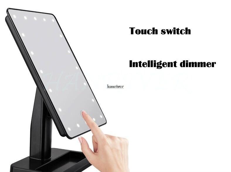 Botão alto do toque do espelho da