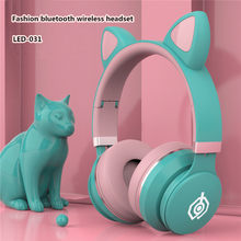 New head-mounted cute fashion cat ear headset wireless bluetooth headset with mic music call heavy bass wired gaming headset(China)
