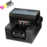 Impresora de inyección de tinta automática A3 UV impresión en botella común de vidrio de madera metal acrílico Impresión de cuero A3 impresora UV plana