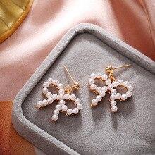 Korean Pearl Net Red Bow Earrings Cute Sweet Simple Personalized Earrings Temperament Fashion Accessories Wholesale new korean fashion earrings simple gold geometric wave temperament pearl pendant wholesale trendy earrings