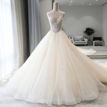 Robe de mariée princesse, corps de cristal perlé brillant, ligne a, bretelles sur les épaules, effet dillusion pour le dos nu