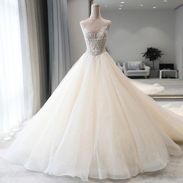 מבריק חרוזים קריסטל גוף נסיכת חתונה שמלות אונליין Vestido Noiva כתף רצועות ללא משענת כלה אשליה