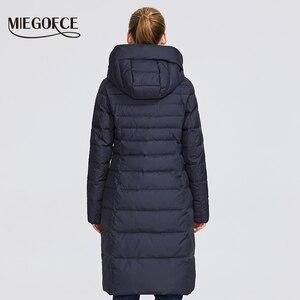 Image 4 - MIEGOFCE 2019 Новая зимняя женская коллекция курток длина до колен ветрозащитный женская куртка со стоячим воротником и капюшоном имеет наладные карманы на молнии двойная защита от холода на молнии и на застежках