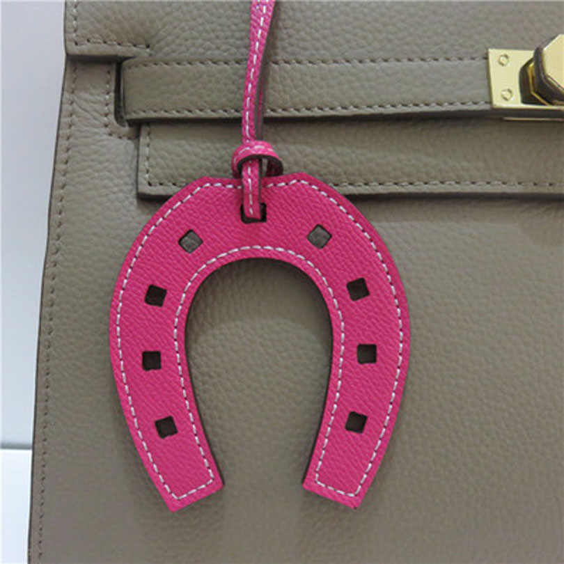 Marca de moda PU cuero caballo Hoof Horseshoe llavero de bolso de mano anillo titular encanto mujer bolso accesorios dropshipping