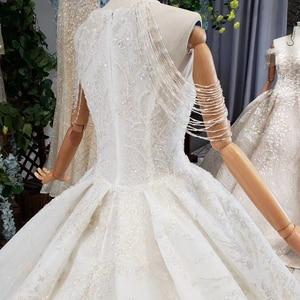 Image 5 - HTL620 vestidos de casamento com long train mangas beading lantejoulas zipper O Pescoço plissado vestido de noiva uma linha vestido de novia 2019