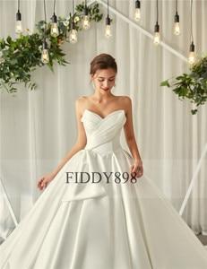 Image 5 - ロイヤルウェディングドレス 2020 V ネックソフトサテンのウェディングドレスふくらん夜会服フリルブライダルガウンロングトレイン Vestido デ noiva