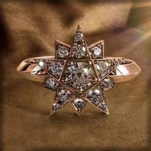 Кольцо женское из розового золота с фианитом и камнем