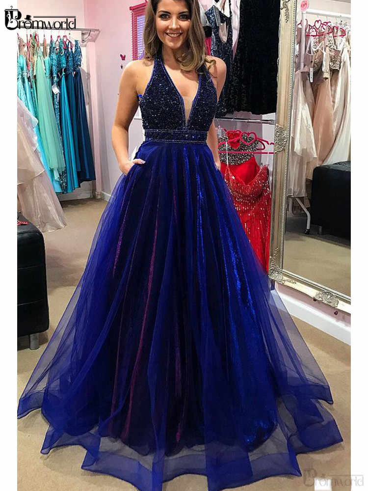 Świecąca królewska niebieska sukienka na studniówkę 2020 z koralikami kieszenie A-Line dekolt w serek tiul długa suknia balowa Backless Sexy formalna suknia wieczorowa