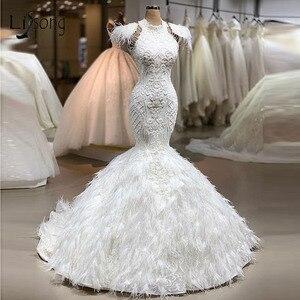 Image 1 - Echt Bild Luxus Feder Weiß Meerjungfrau Hochzeit Kleider 2020 Spitze Brautkleider Nach Maß Dubal Hochzeit Kleider