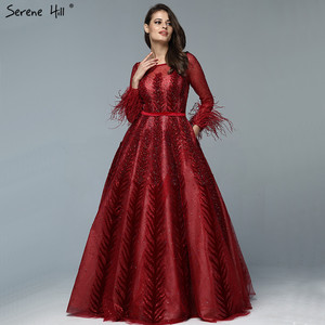 Image 1 - Lüks şarap kırmızı Dubai tasarım abiye uzun kollu tüyleri kristal resmi elbise 2020 Serene tepe LA70013